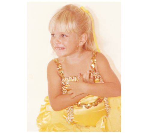 A picture of a little girl at a ballet recital in a yellow leotard with sequins and a tutu.  This is a picture of the wedding photographer, Debra Eby, Jacksonville fine art wedding photographer, when she was a little girl..