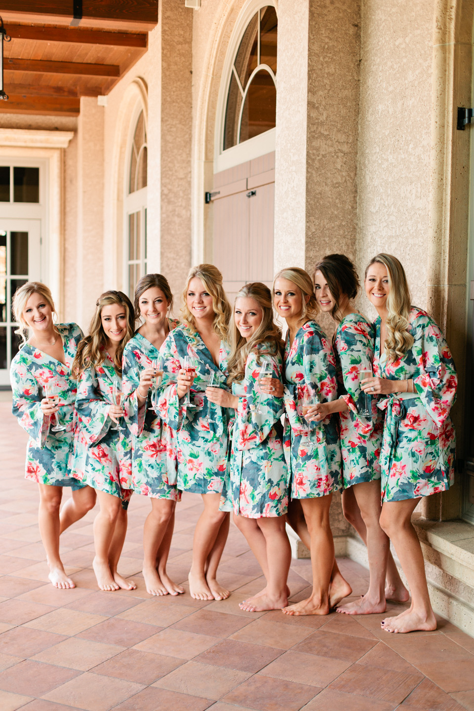 Picture of bridesmaids in floral robes getting ready for a wedding day at TPC Sawgrass in Ponte Vedra, Florida