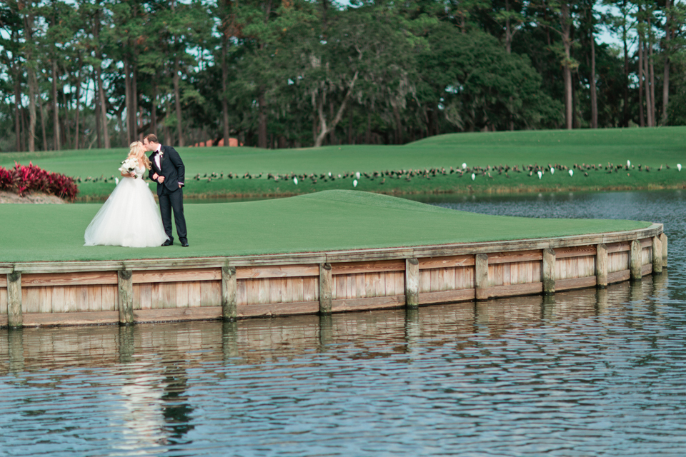 "Image of a bride and groom having a ""first look"" on the 17th hole at TPC Sawgrass in Ponte Vedra, Florida"