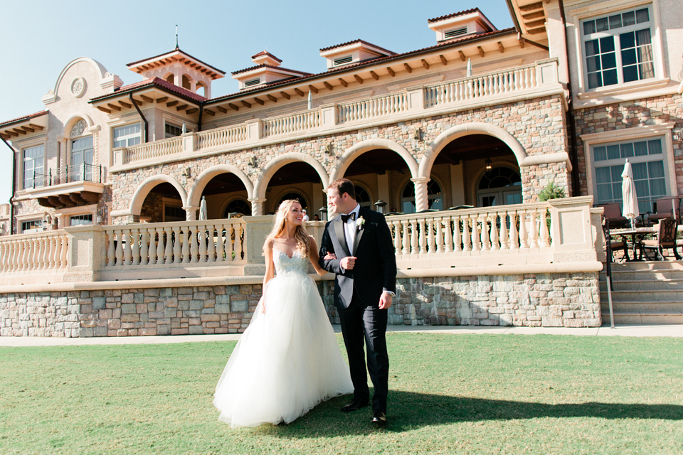 Image of a bride and groom walking arm in arm on their wedding day at the TPC Sawgrass in Ponte Vedra, Florida