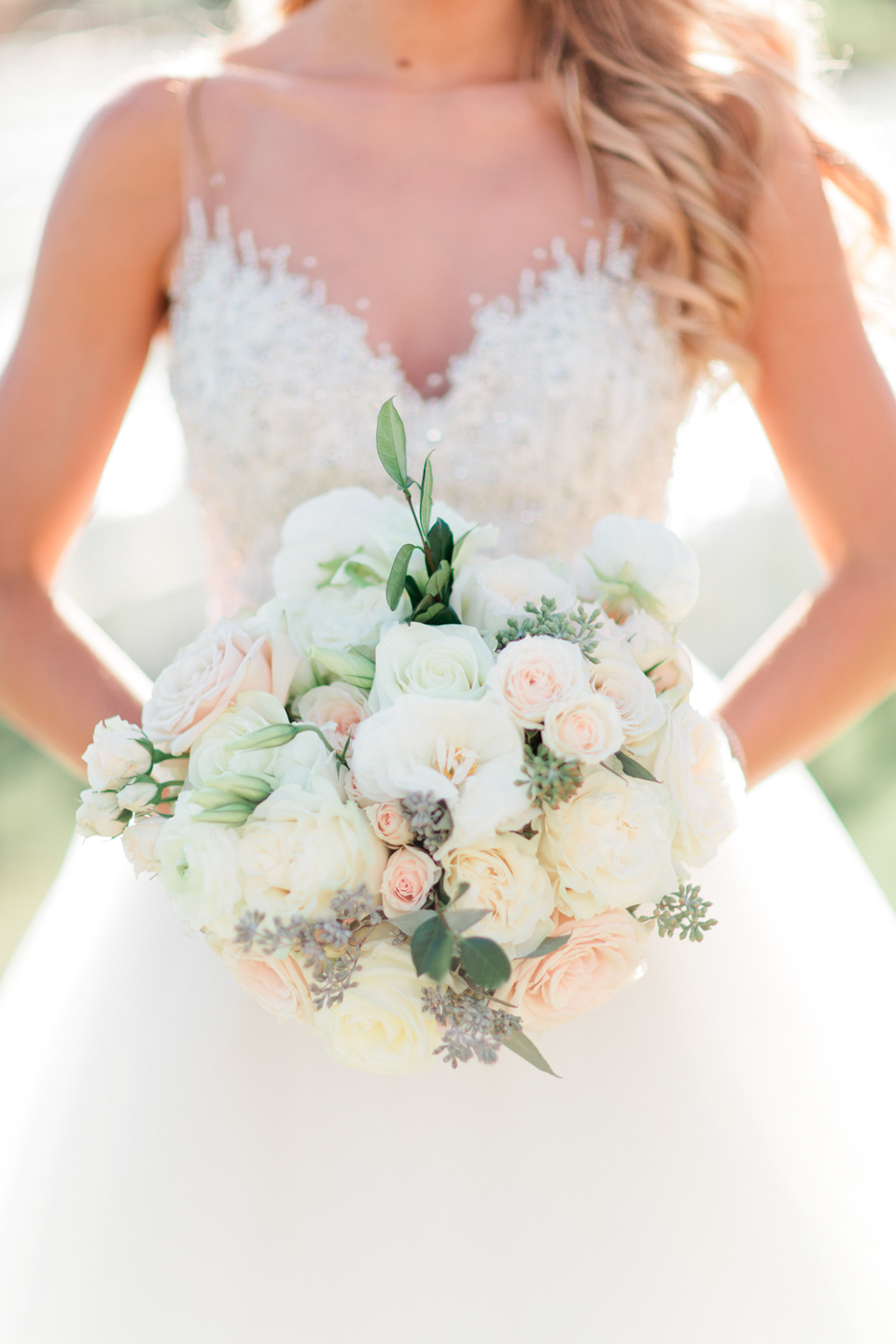 Image of a bride holding her bridal bouquet with white blossoms at TPC Sawgrass in Ponte Vedra, Florida
