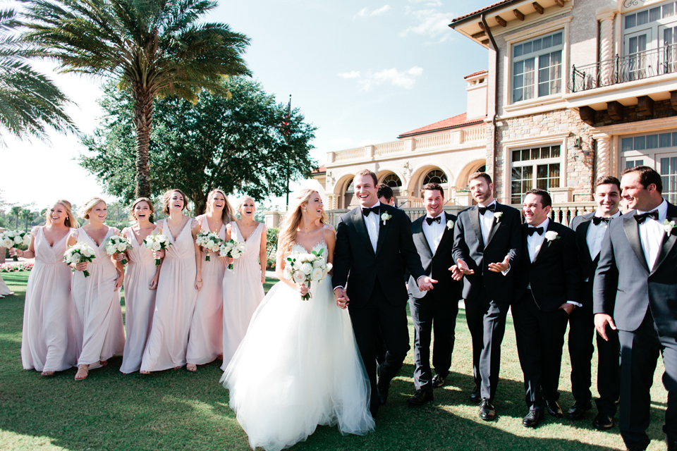 Image of the bridal party walking on the wedding day at TPC Sawgrass in Ponte Vedra, Florida