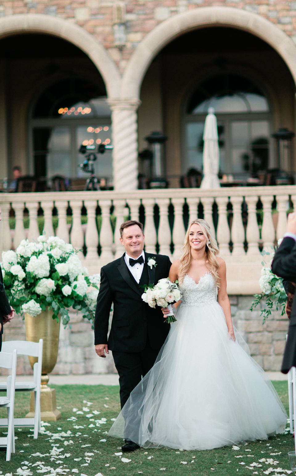 Picture of a father walking his daughter down the aisle on the wedding day.  The wedding is at TPC Sawgrass in Ponte Vedra, Florida
