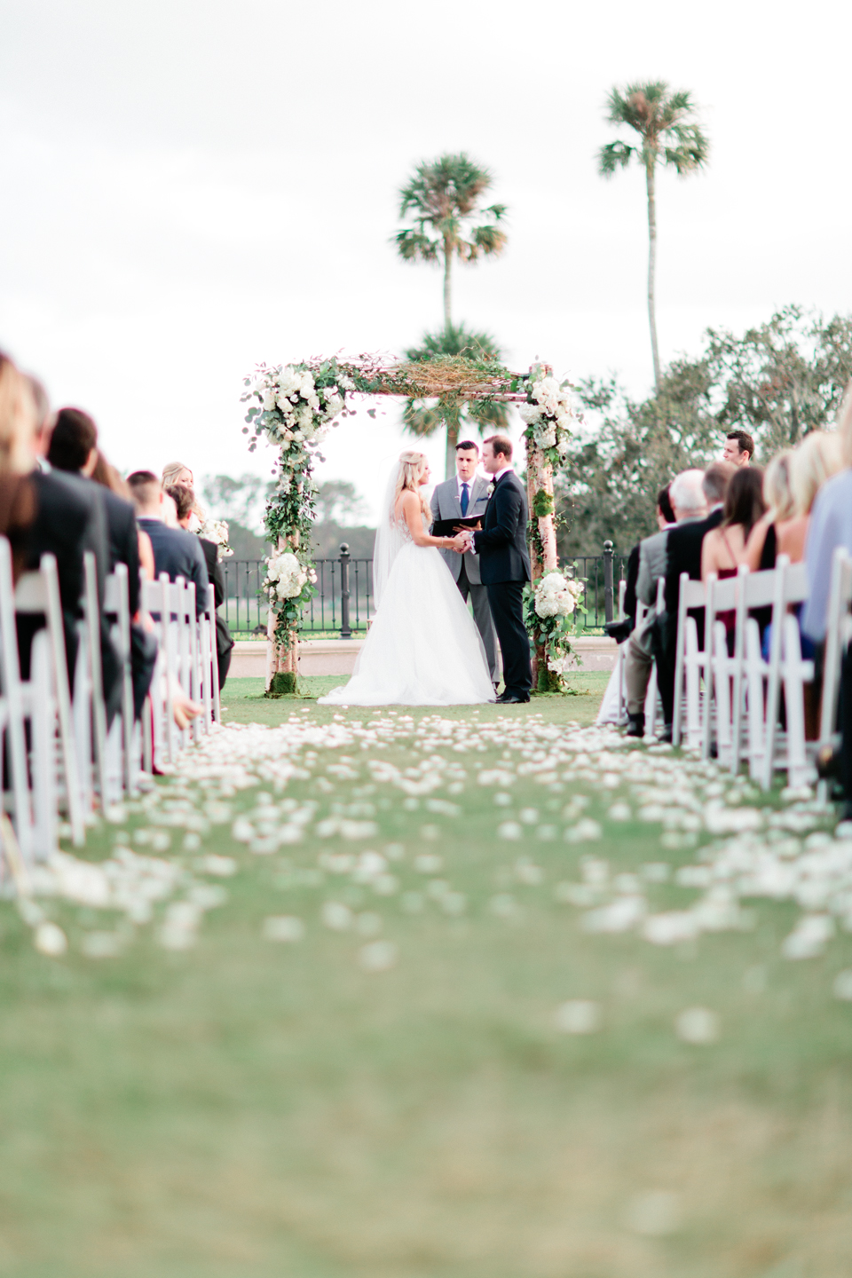 Picture of a bride and groom saying vows on a wedding day at TPC Sawgrass in Ponte Vedra, Florida