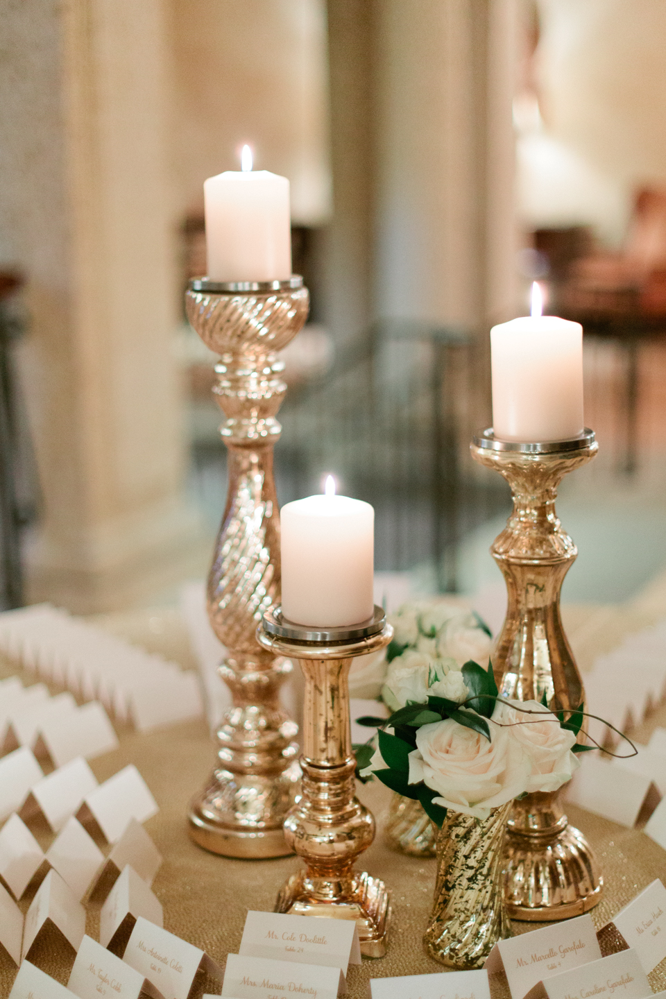 Image of candles on the escort card table at a wedding at TPC Sawgrass in Ponte Vedra, Florida