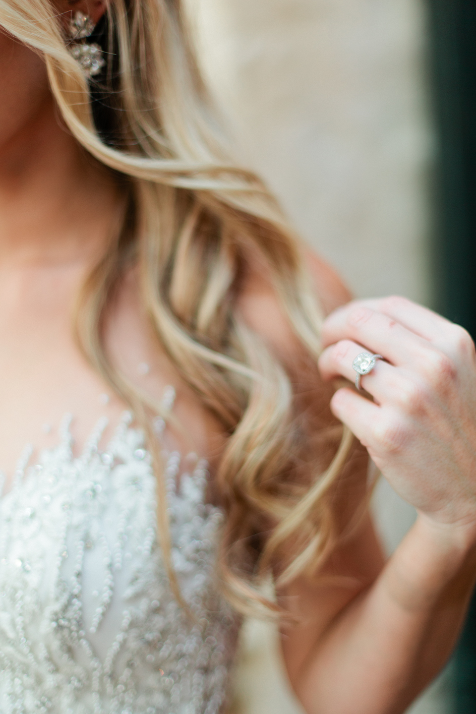 Picture of a close up of a bride and her wedding ring with her long curls.  The bride is at the Epping Forest Yacht Club in Jacksonville, Florida