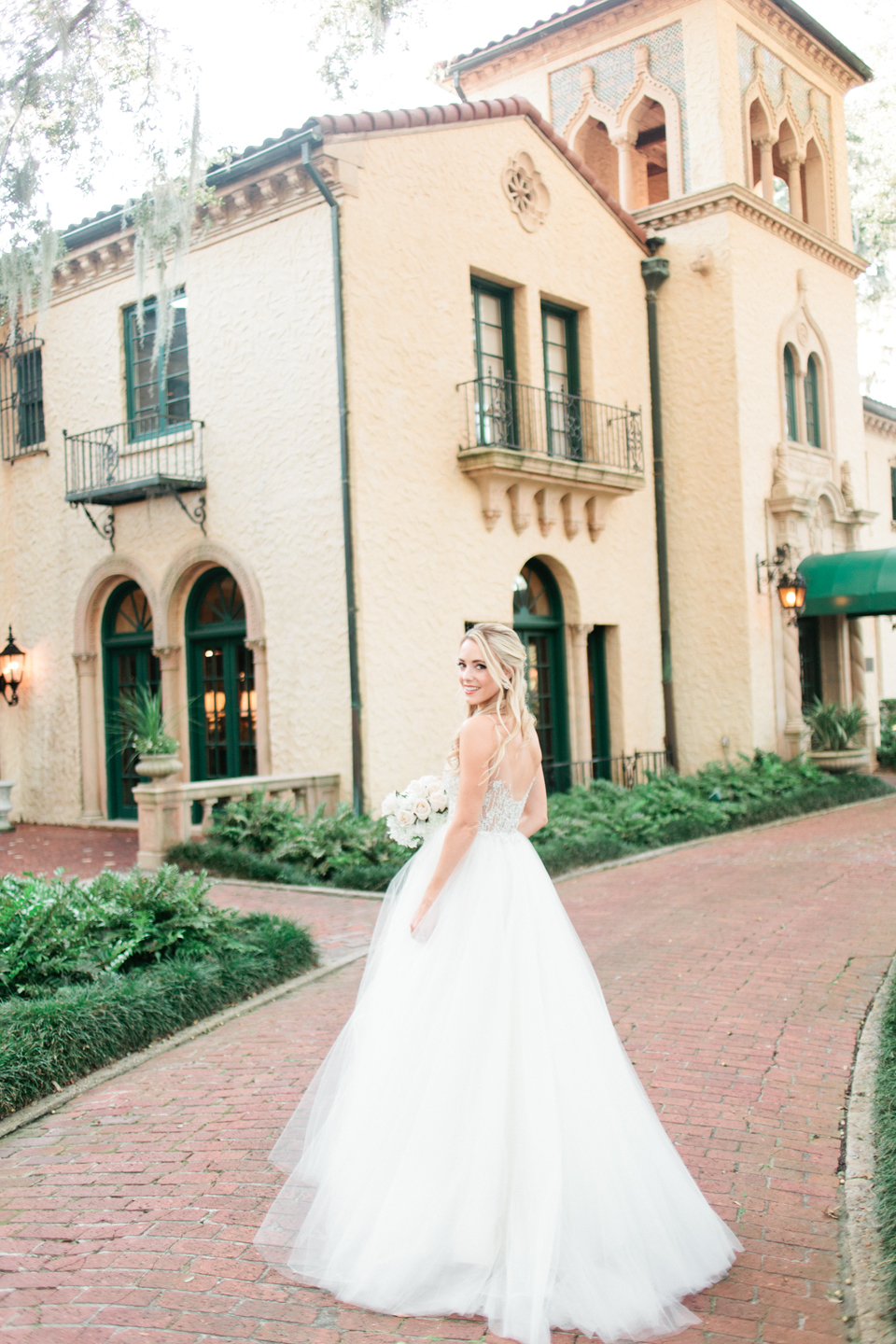 Image of a bride in a wedding gown in front of Epping Forest Yacht Club in Jacksonville, Florida.