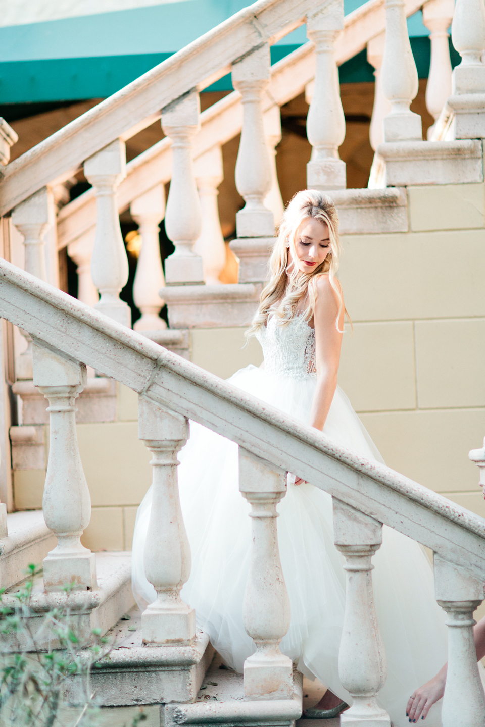 Picture of a bride in a wedding gown on a staircase at the Epping Forest Yacht Club in Jacksonville, Florida