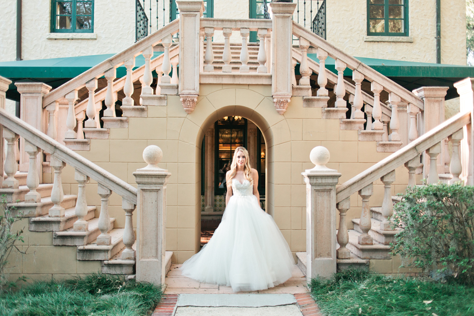 Image of a bride in a Calvet Couture wedding gown in front of the Epping Forest Yacht Club in Jacksonville, Florida