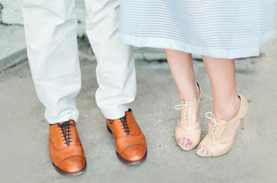 Picture of a couple and their cute shoes.  This picture was taken on the steps of the Henry B. Plant museum in Tampa, Florida.  These are engagement portraits.