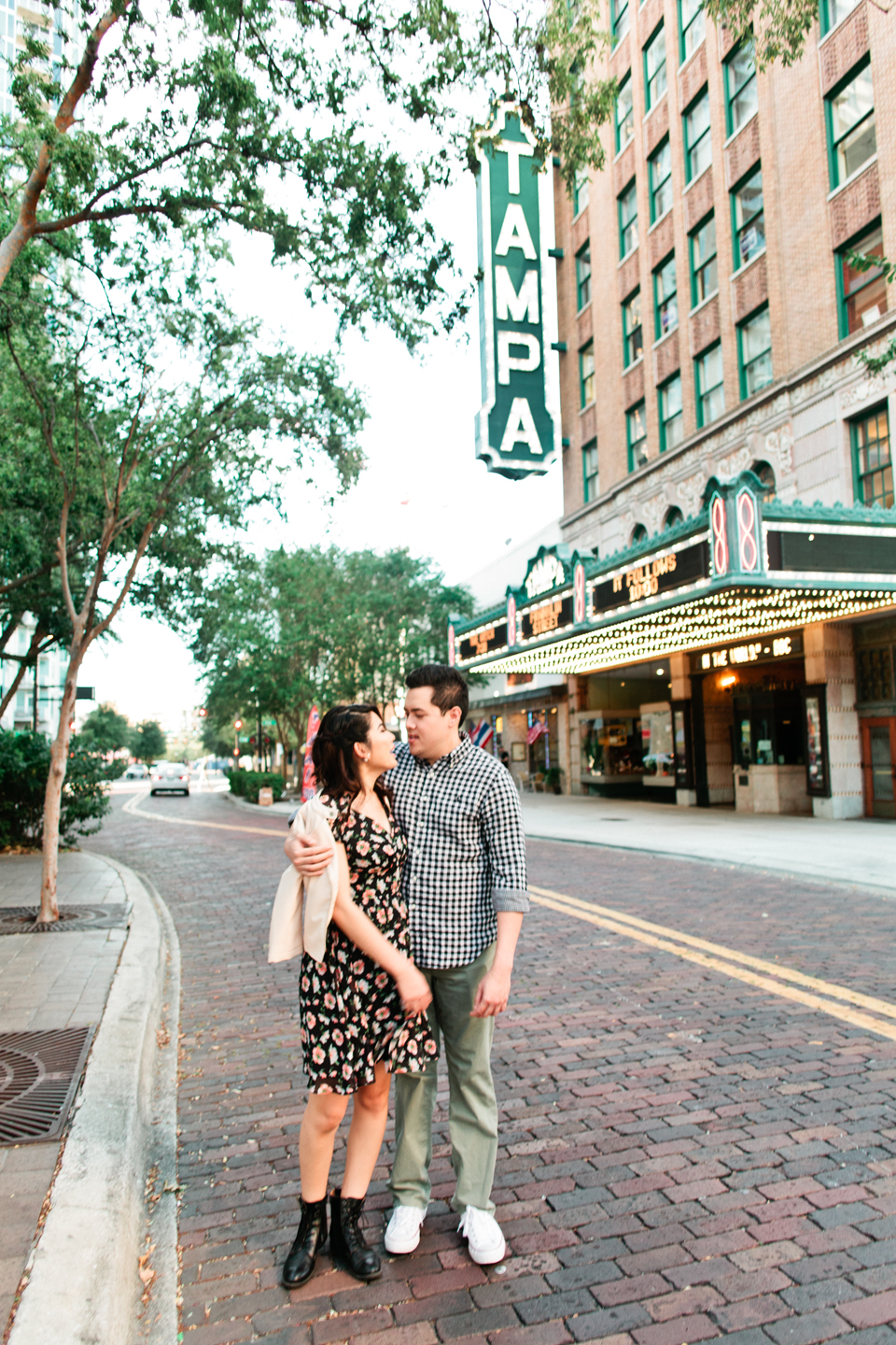 Image of an engaged couple in front of the Tampa Theater, downtown Tampa, Florida.