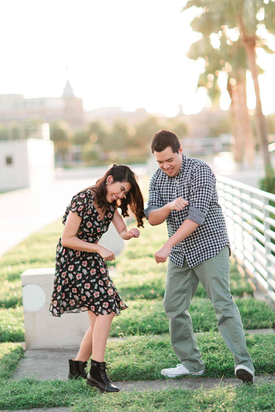 Picture of a cute couple dancing at Curtis Hixon Waterfront Park in downtown Tampa, Florida.  This is an engagement portrait.