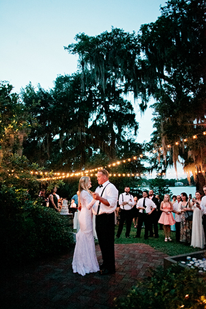 Wedding Reception Photography, father/daughter dance under cafe lights. | Debra Eby Photography Co.