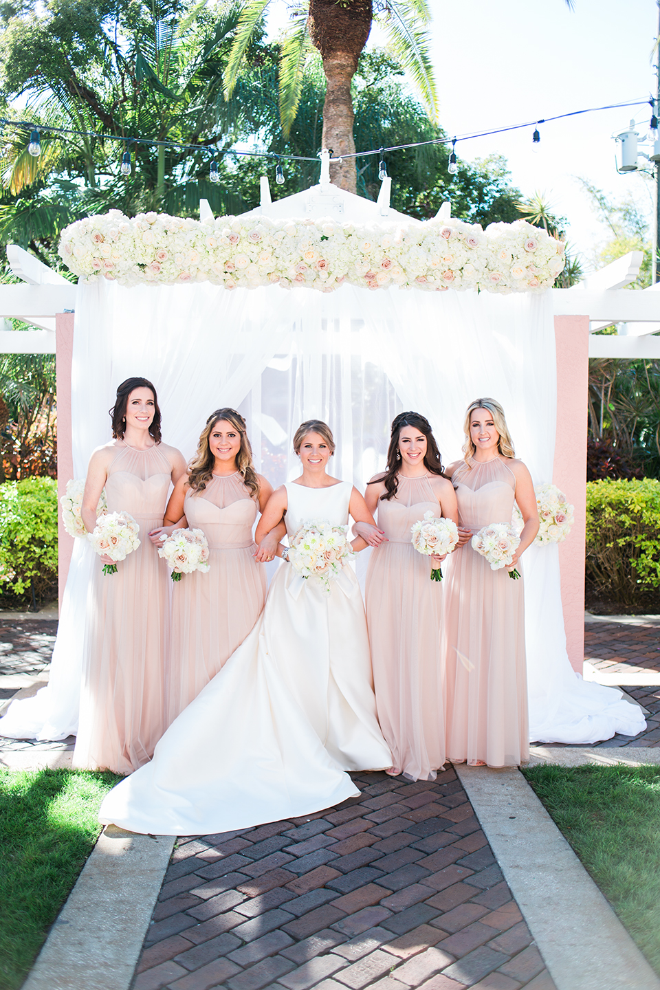 Bride with her bridesmaids on her wedding day at The Vinoy in St. Pete, Florida | Debra Eby Photography Co.