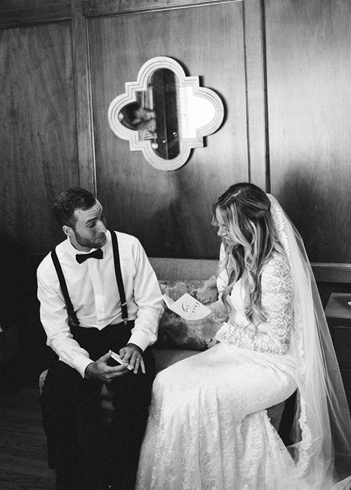 At this wedding, the bride and groom took a moment to read their personalized vows to each other in the privacy of an office suite.