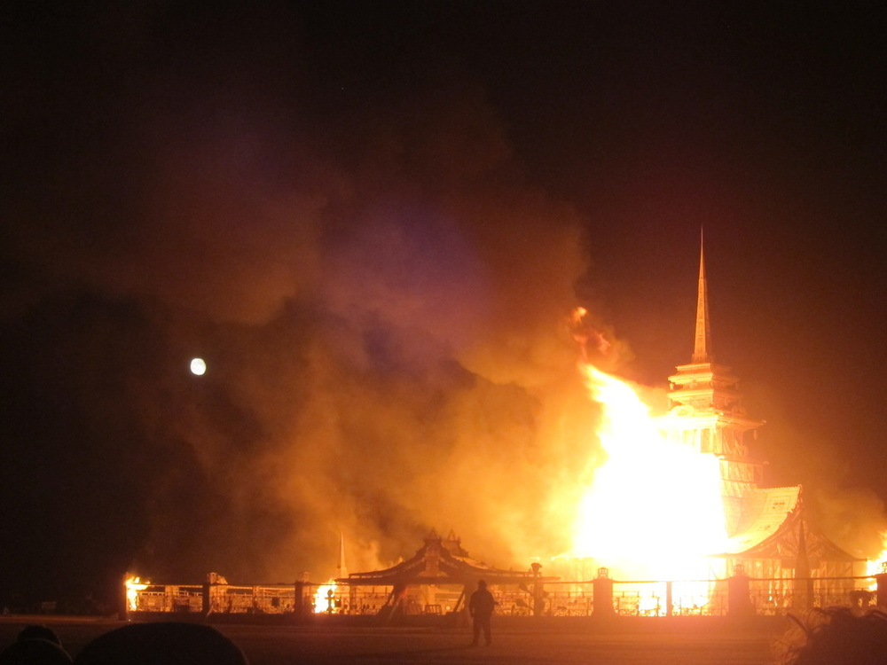 the temple burns by the light of the moon