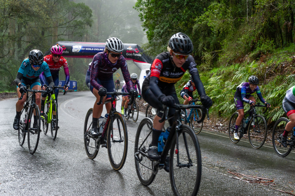 Emma (far left) goes over the second QOM in the lead group. Photo credit: Photos by Ernesto.