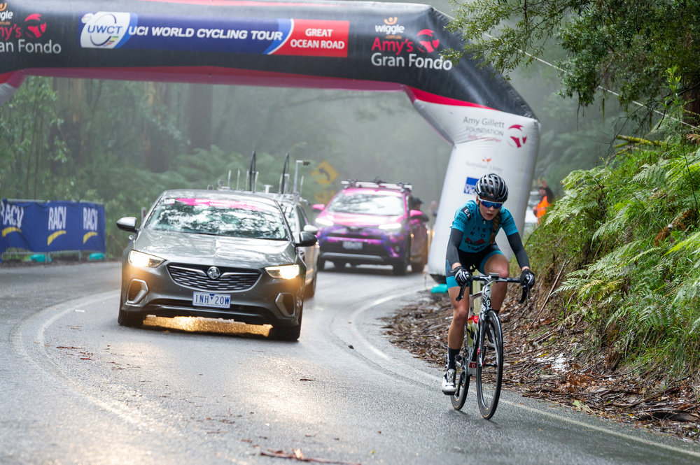 Emma crests the second QOM a few seconds behind the lead bunch. Photo credit: Photos by Ernesto.