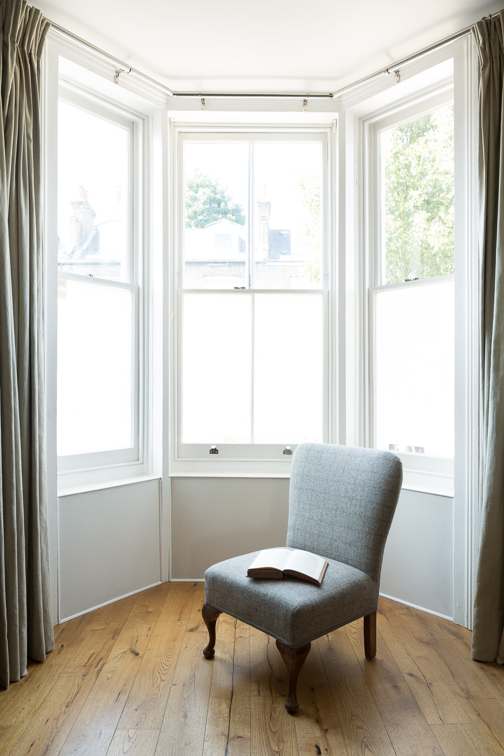 Chris kept the original sash windows in this bay but replaced the single glazing with super-thin double glazing, and the walls below have internal insulation added to them. It all adds up to a cozy, draught-free place to read a book...