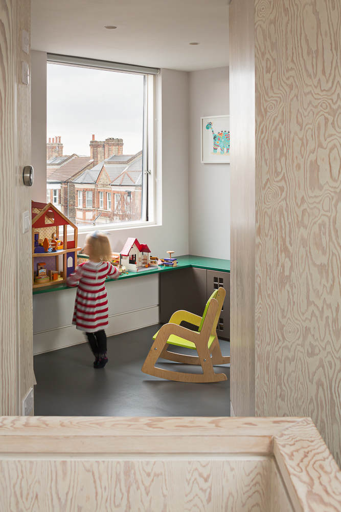 The children have the run of the loft floor, with a bedroom, play room, and play area on the landing.
