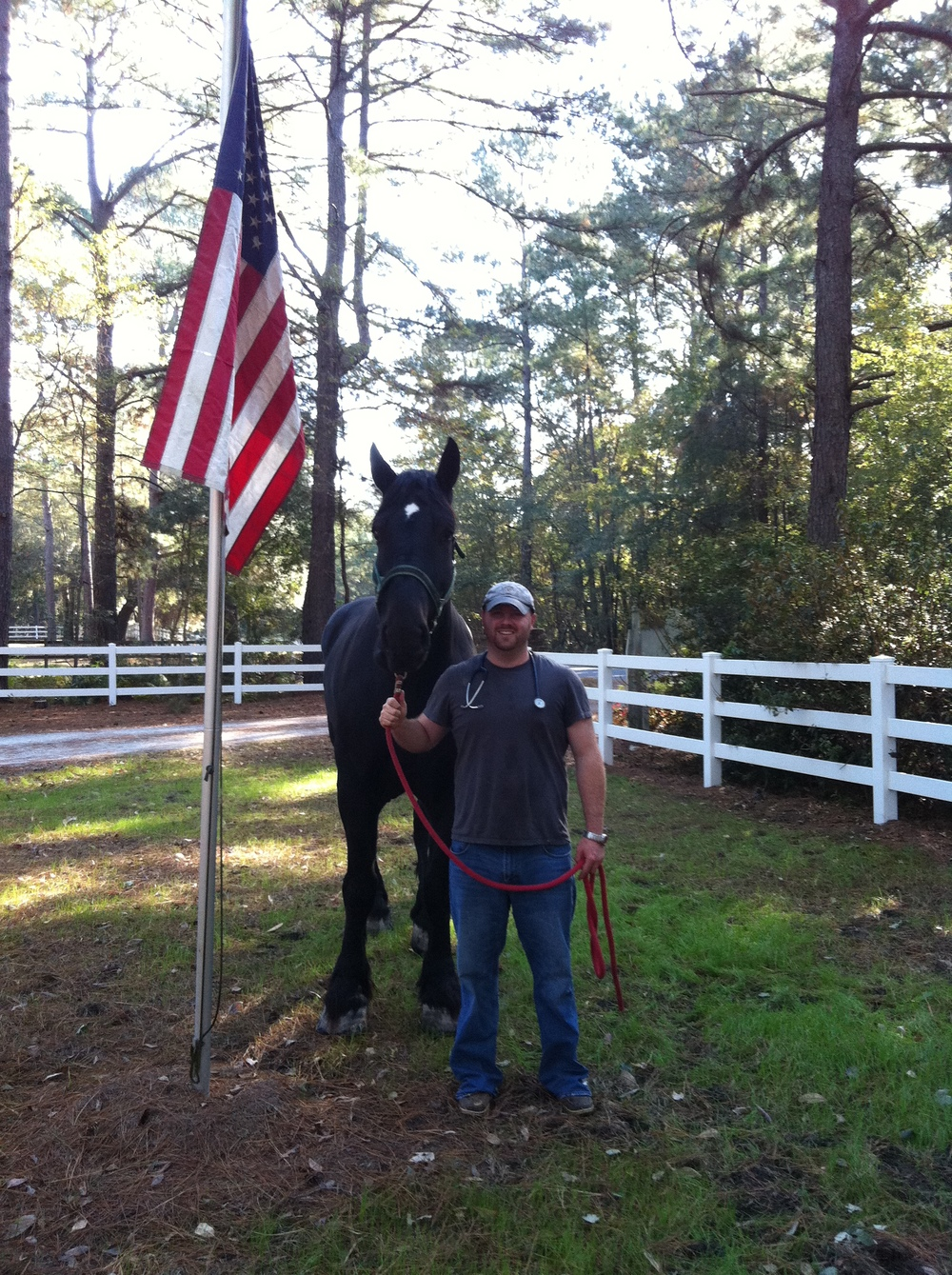 Dr. Laster with Dakota, a carriage horse in Charleston.