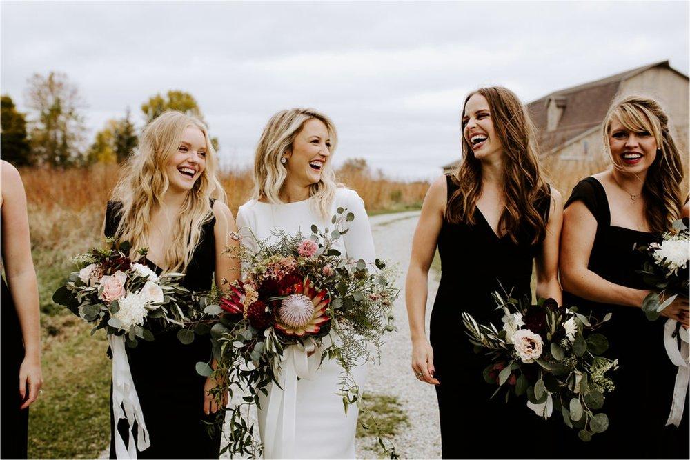 minnesota boho bride and bridesmaid farm wedding