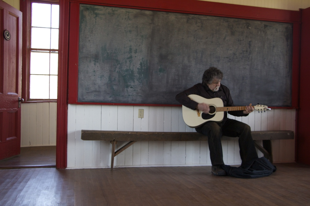 My uncle Pierre (who came from BC to help us set up and to be there for the opening) tested out the acoustics in the schoolhouse.