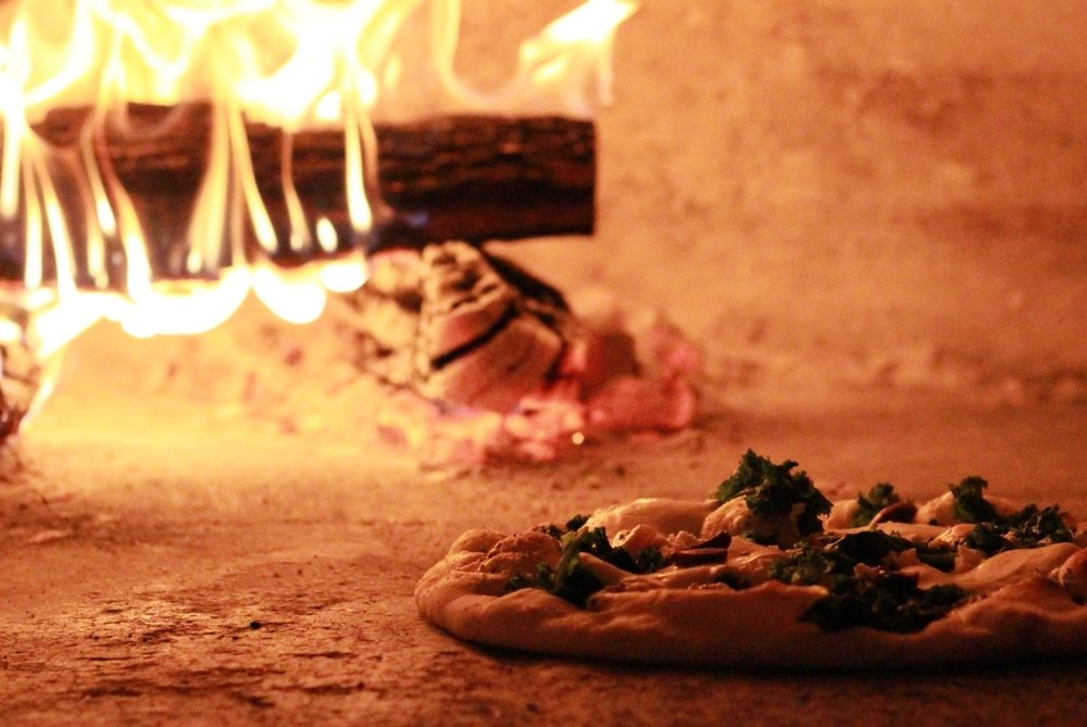 Kale Pizza in a wood-fired pizza oven.