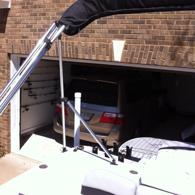 The bimini top folds out to give shade to all passenger seated on the couch seating.