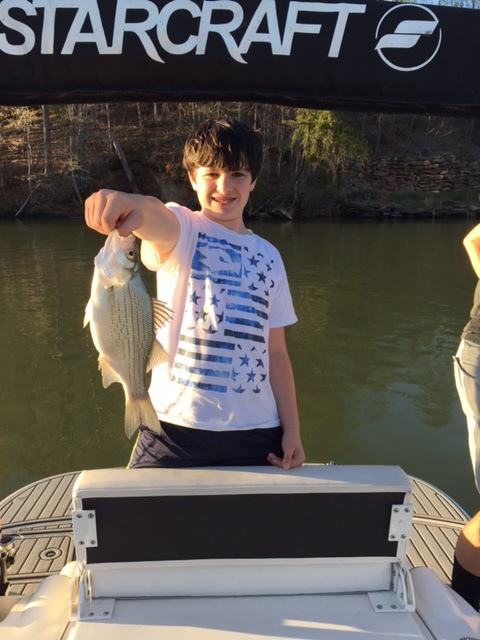 Here's one of my boys with a nice white bass.  White bass were scattered near points.  Largemouth wanted trick worms in 4 - 10 foot water just off the current.  The largemouth were ignoring baitfish today.  They were keyed in on the smorgasbord washing in.