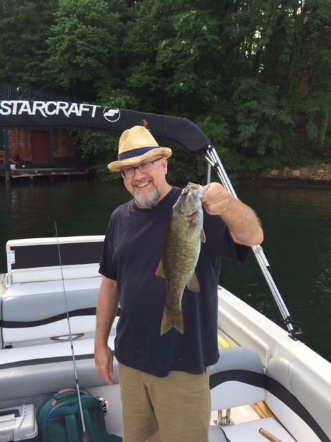Here is Eric with a nice small mouth bass.