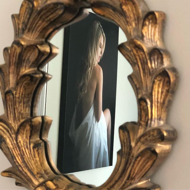 This pretty #gold mirror hangs next to our dressing room, and this canvas fine art print is the perfect reflection.  #photographystudio #reflection #fineartphotography #studiomoments #losangelesphotographer