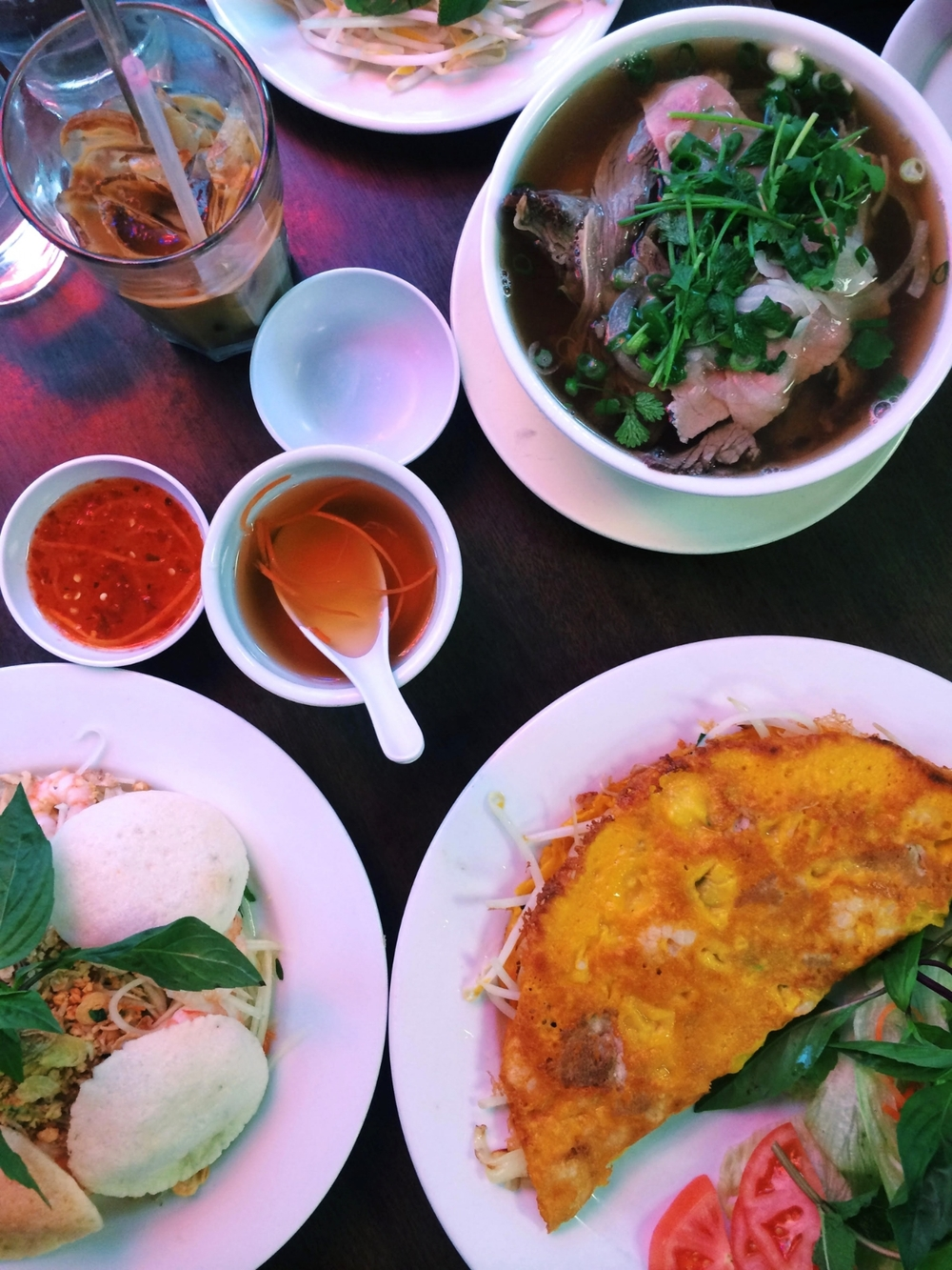 From Top, Clockwise: Pho with Eye Round, Bunh Xeo, and Shrimp and Papaya Salad