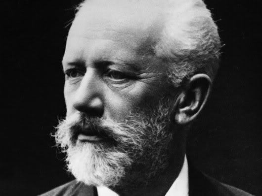 A profile of Tchaikovsky with sad eyes and a short white beard.