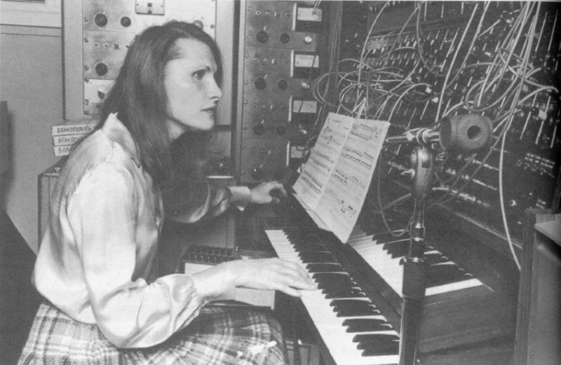 Wendy Carlos draped over an electronic piano