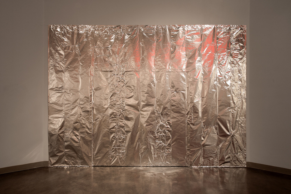 impossible monument   tin foil, silver powder, lettering  12'x16'  2013