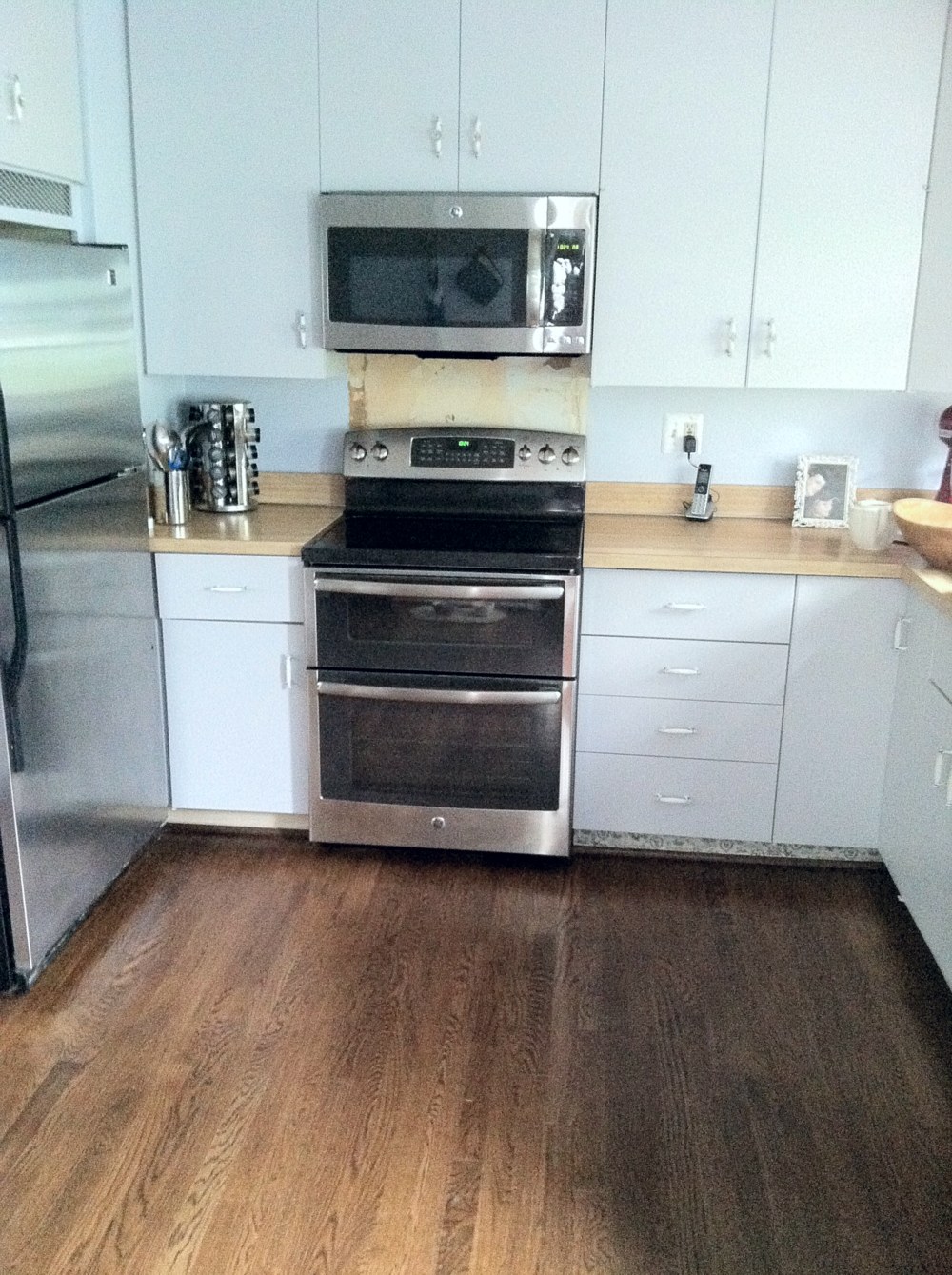 We replaced the beige appliances with stainless steel! When we removed the beige appliances, we noticed some amazing 1970's wallpaper lurking. Of course, we removed the floral eyesore, but was left with an even bigger eyesore.