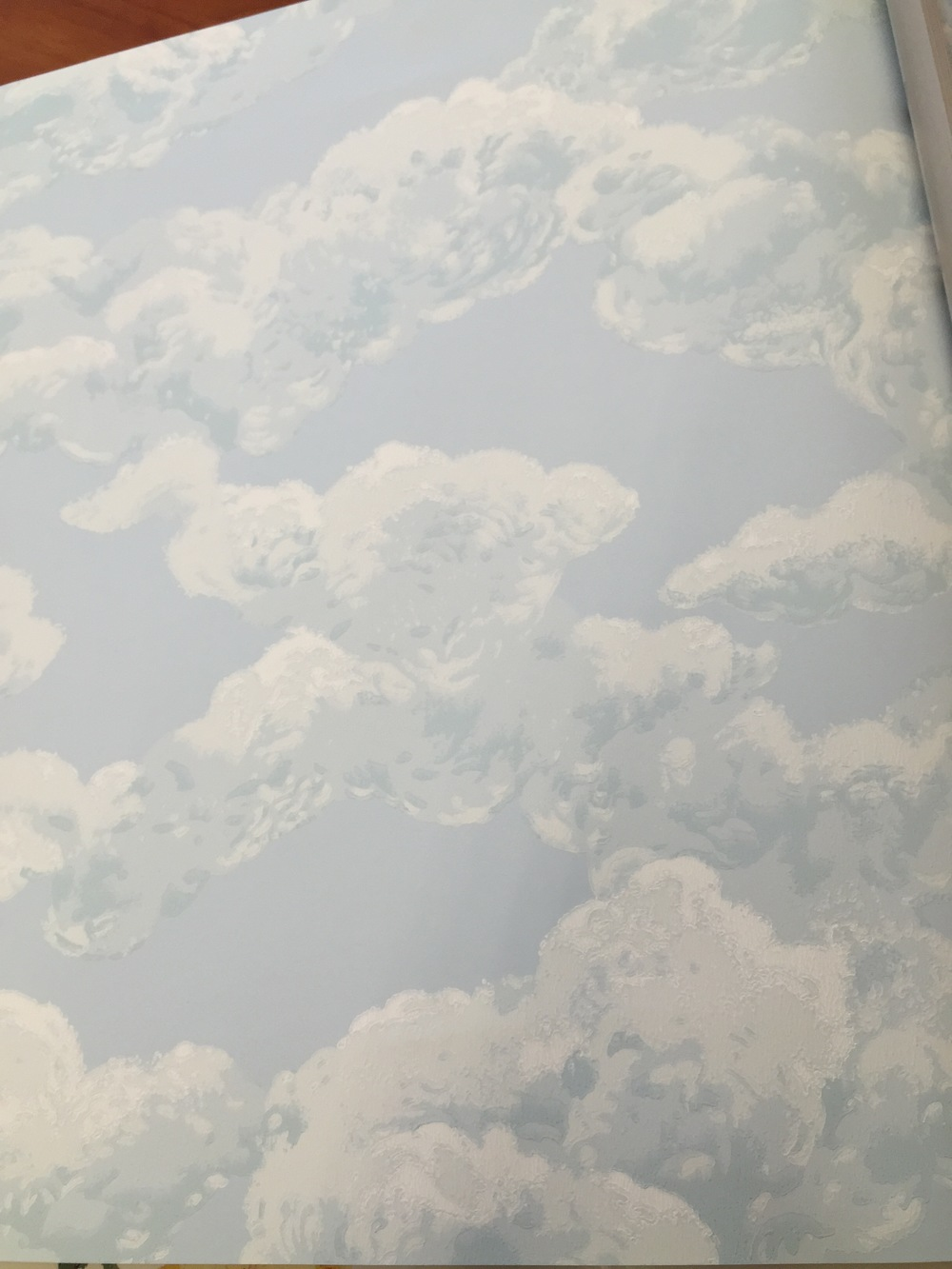 I found this wallpaper at Sherwin Williams and was super pumped. I wanted to create a nursery with an ethereal feeling. My thought was to put this on the ceiling, so we ordered this and matched our paint to the blue.