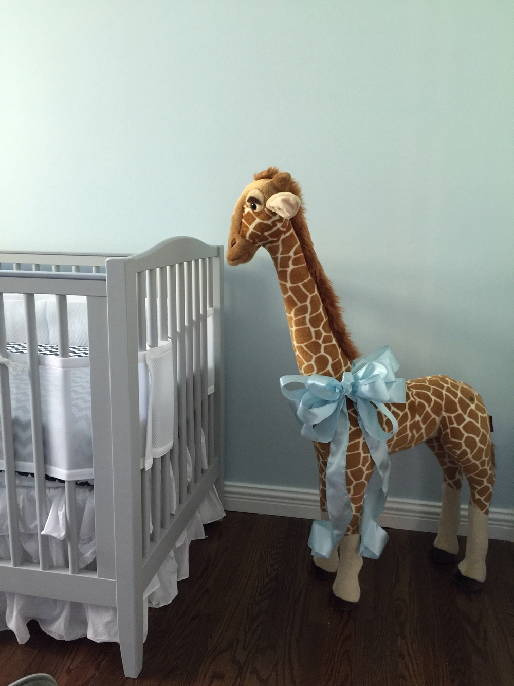 A couple of days before my scheduled c-section, I had this feeling that the nursery was missing something. We went to BRU and then I saw the giraffe. I just had to have it for my son's room. I probably looked pretty funny when I was leaving the store. My husband was steering the cart packed with other random crap that I thought we needed, so I had the honor of holding the giraffe as I waddled out of the store. We stopped at Michael's on the way home because we both thought the giraffe needed a massive bow.
