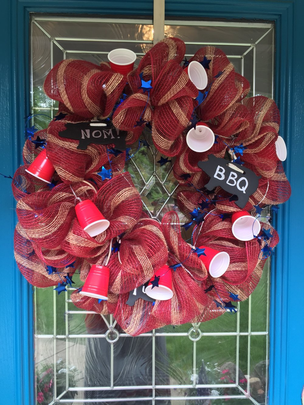 I was obsessed with the little red plastic cup lights that I bought from the Dollar Tree. It was perfect for the deco mesh wreath I made for the BBQ.