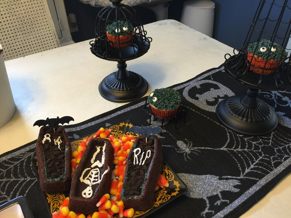 The Coffin Cakes were a big hit, along with the spider cupcakes. Yum! Interested in making them next year? I picked up the Wilton Coffin mold from Michael's and then piped the skeleton inside.
