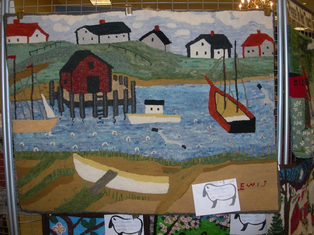 One of the Maud Lewis recreations in hooking.
