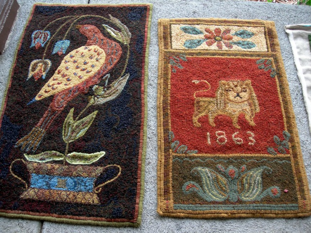 "The ""Virginia Fraktur"" rug on the left was designed by Barb Carroll and hooked by Liz Gordon, using some paisley fabric in the bird's body. The rug on right was designed and hooked by Liz Gordon.  She combined an antique coverlet lion and a Penn Dutch bookplate design."