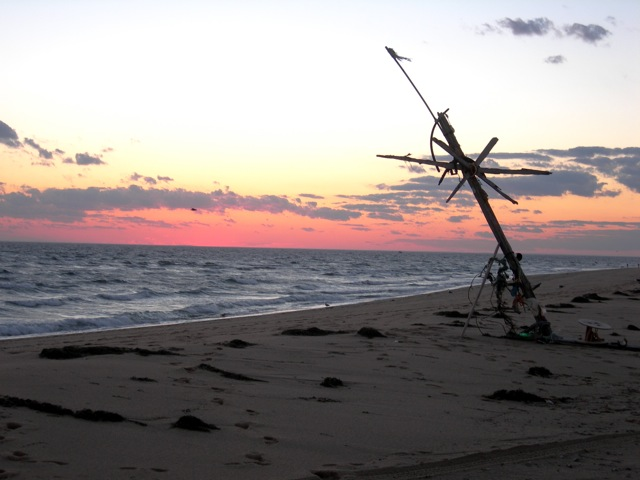 "The beach and ""beach art"" at sunset.  Because the tip of Cape Cod curves around, one sees the sun set over water.  An unusual sight on the east coast!"