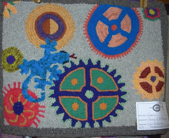 This Gears rug hooked by Gloria McPherson, a fellow Magdalena Rug Hooker, was there.... as well as many many other great rugs.