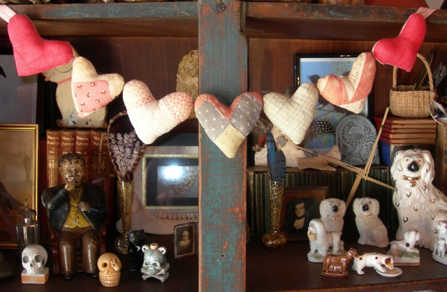 "A string of hearts I made many years ago from a ""cutter"" quilt."
