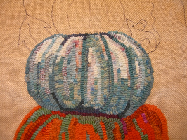 A close-up showing the many different blue wools used in this gourd.