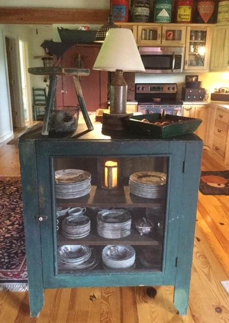 I just love this prim pie safe in original green finish.  It has the screening on all four sides.  My dishes have never been so happy!