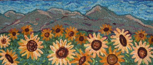 Sunflowers for Sarah , hooked a few years ago for our daughter-in-law.  Grizzly Peak in Ashland, OR is in the background.