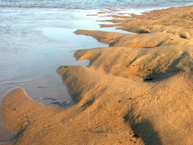 I love this sculpted edge of the beach at low tide.